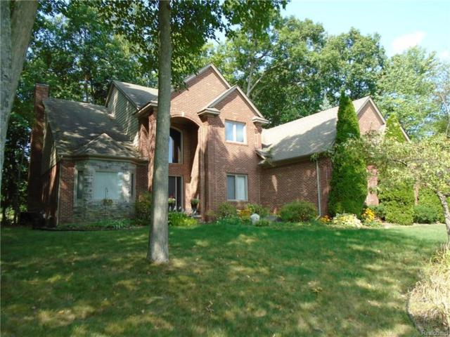1713 Gleneagles Drive, Highland Twp, MI 48357 (#217107520) :: Simon Thomas Homes
