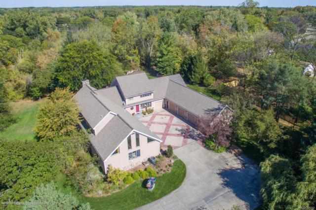 1820 Canyon Trail, Delta Twp, MI 48917 (MLS #630000221033) :: The Toth Team