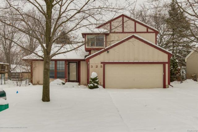 325 Park Meadows Drive, Delta Twp, MI 48917 (MLS #630000222268) :: The Toth Team