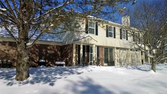 2128 Hidden Meadows Dr Unit B, Walled Lake, MI 48390 (#218011861) :: RE/MAX Classic