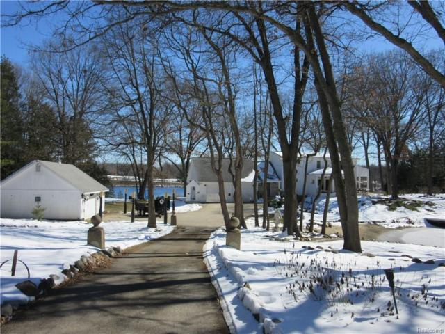 495 Peninsula Lake Drive, Highland Twp, MI 48357 (#218022656) :: Duneske Real Estate Advisors