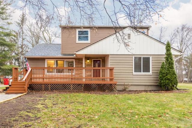 12060 9 Mile Road, Green Oak Twp, MI 48178 (MLS #543255435) :: The Toth Team