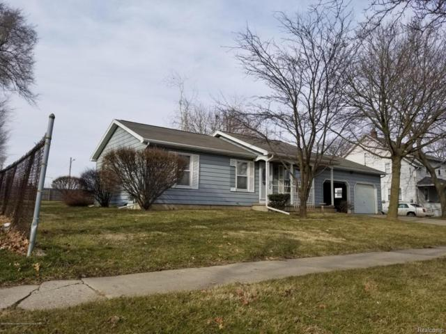 717 E Bates, Lansing, MI 48906 (MLS #630000224814) :: The Toth Team