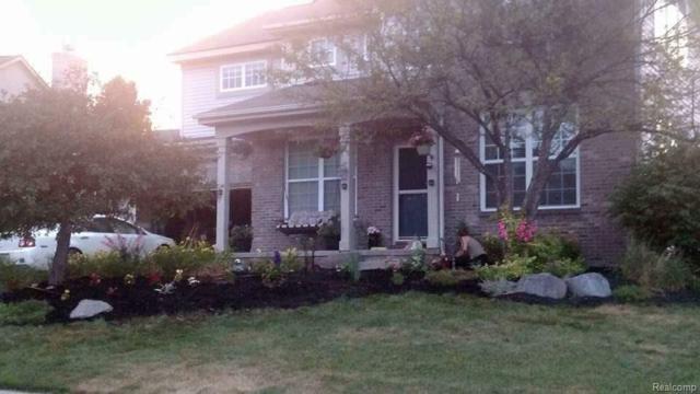 1400 Four Seasons Drive, Hartland Twp, MI 48843 (#218031704) :: The Mulvihill Group