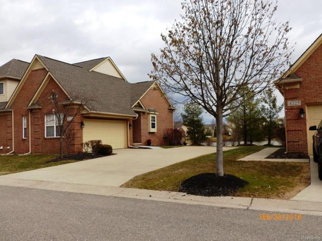 4207 Forest Bridge Drive #56, Canton Twp, MI 48188 (MLS #218032264) :: The Toth Team