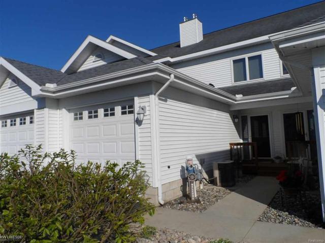 915 W Lake St, Tawas City, MI 48763 (#58031347562) :: Duneske Real Estate Advisors