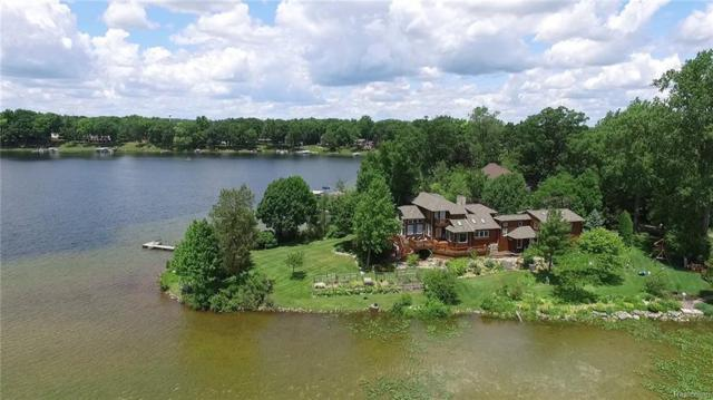 1311 Sylvan Drive, Hartland Twp, MI 48353 (#218044409) :: The Buckley Jolley Real Estate Team