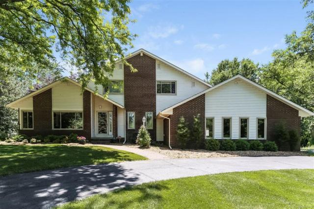 12165 Carriage Trail, Springfield Twp, MI 48350 (#50100002579) :: RE/MAX Classic