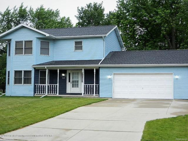 5611 Pembrook Place, Delta Twp, MI 48917 (#630000227585) :: The Mulvihill Group