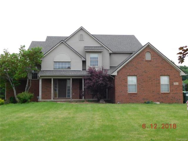 8879 Giovanni Court, Howell, MI 48855 (#218059129) :: The Buckley Jolley Real Estate Team
