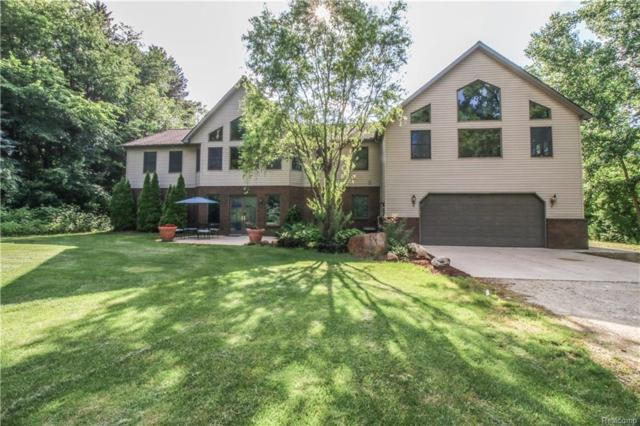 15260 Stone Henge Drive, Holly Twp, MI 48430 (#218059517) :: RE/MAX Classic
