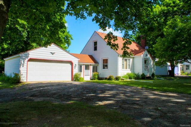 4942 Old Lansing Road, Delta Twp, MI 48917 (#630000227996) :: Duneske Real Estate Advisors