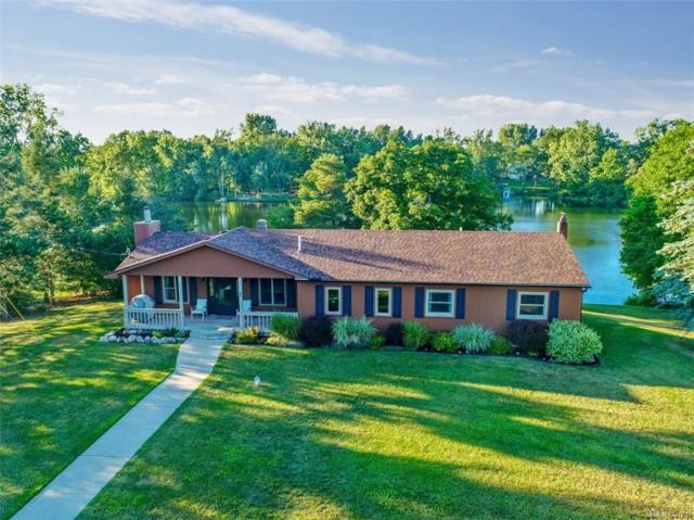 1498 Middle Road, Highland Twp, MI 48357 (#218061632) :: The Mulvihill Group