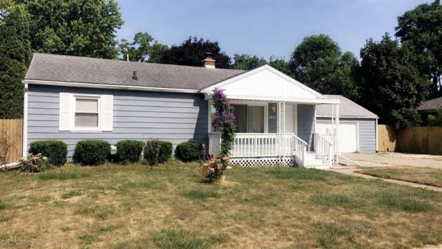 2601 Pleasant Grove Road, Lansing, MI 48910 (#630000228207) :: Duneske Real Estate Advisors