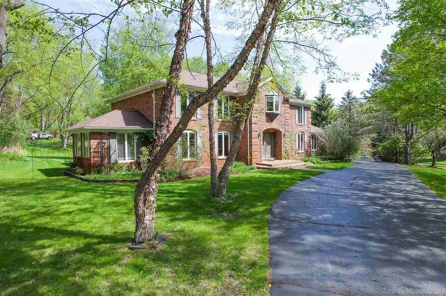 5645 Oak Bluff Rd., Oakland Twp, MI 48306 (#58031353815) :: Duneske Real Estate Advisors