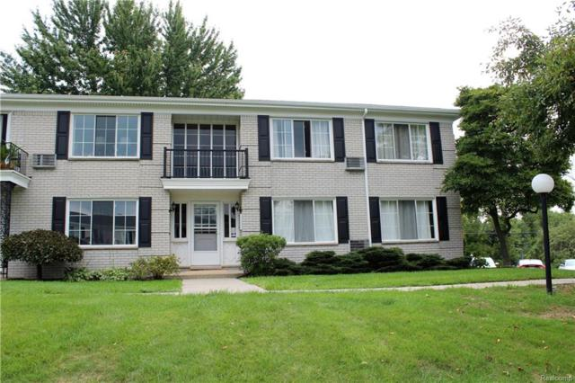 100 W Hickory Grove Road #6, Bloomfield Twp, MI 48304 (#218081091) :: Duneske Real Estate Advisors