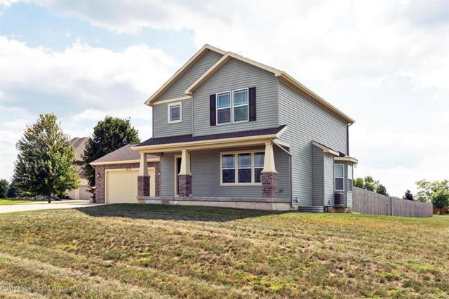 2117 Winners Circle Circle, Bingham Twp, MI 48879 (MLS #630000229855) :: The Toth Team