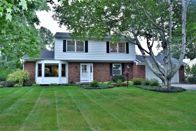 1873 Ridgewood Drive, East Lansing, MI 48823 (MLS #630000229972) :: The Toth Team