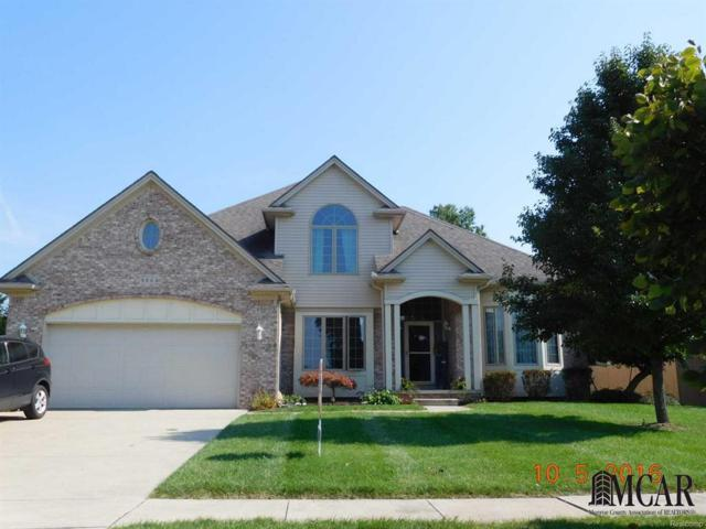 880 Saint Anne Ln, Monroe, MI 48162 (#57021497595) :: The Mulvihill Group