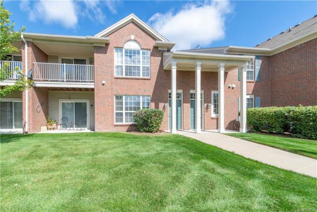 11208 Farmingdale Lane #128, Commerce Twp, MI 48390 (MLS #218090383) :: The Toth Team