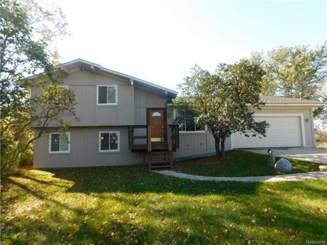 1455 Austin Farms Drive, Groveland Twp, MI 48462 (#218104954) :: Duneske Real Estate Advisors