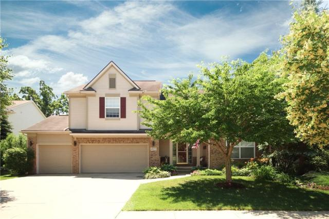 4922 White Tail Court, Commerce Twp, MI 48382 (#218110835) :: The Mulvihill Group