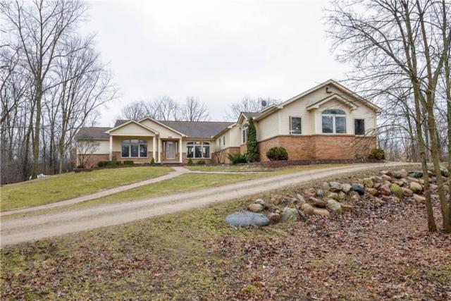 7100 Peninsula Point, Northfield Twp, MI 48189 (MLS #219002166) :: The Toth Team