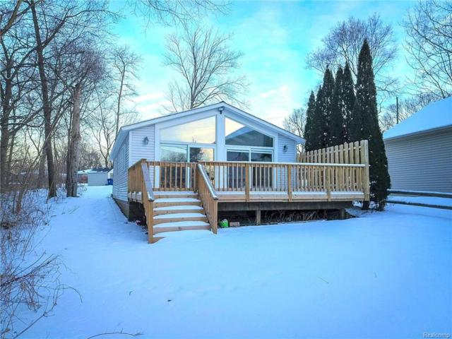 9380 Beechcrest Street, White Lake Twp, MI 48386 (#219014147) :: The Mulvihill Group