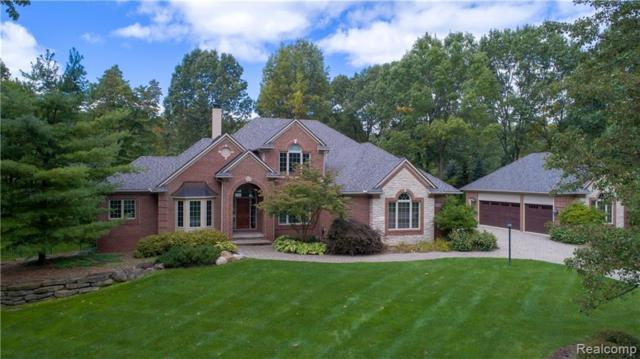 2276 Canterwood, Highland Twp, MI 48357 (MLS #219031703) :: The Toth Team