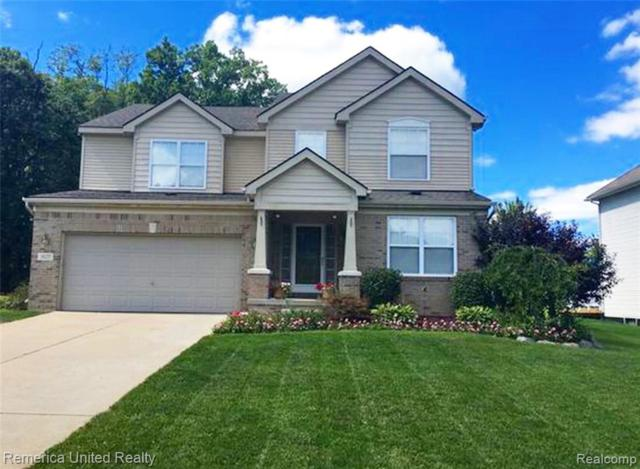 1629 Ashton Ridge Drive, Hartland Twp, MI 48843 (#219033283) :: The Mulvihill Group