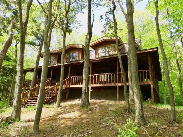 1480 Woodsmere Hills Drive, Village of Grosse Pointe Shores, MI 49635 (#5031379824) :: BestMichiganHouses.com