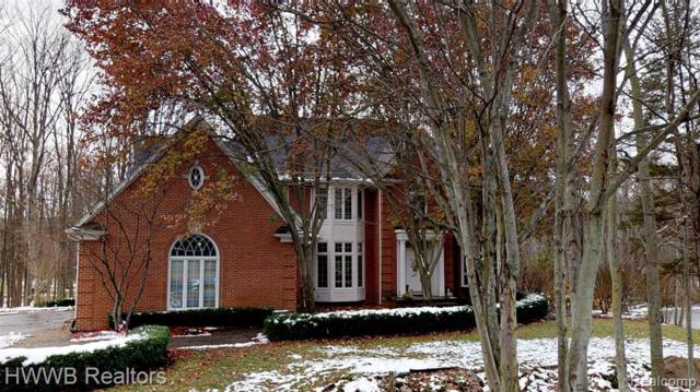5240 Stonehenge Dr, Rochester, MI 48306 (#219045100) :: The Alex Nugent Team | Real Estate One