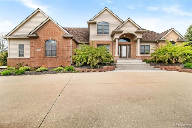 4072 Taggett Lake Drive, Highland Twp, MI 48357 (#219045920) :: GK Real Estate Team