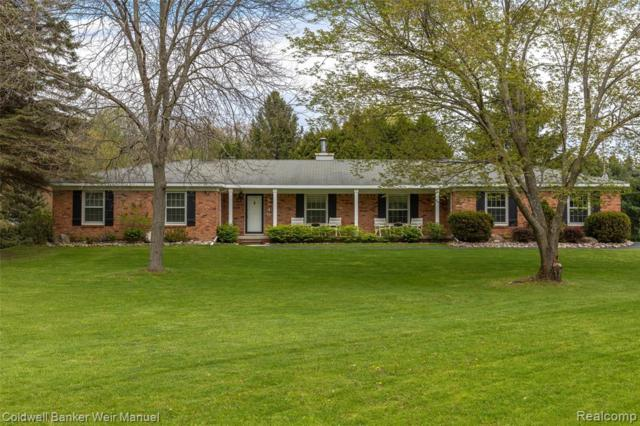 9940 Bridge Lake Road, Springfield Twp, MI 48348 (MLS #219047101) :: The Toth Team