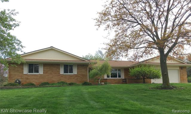 5530 Leafwood Dr Drive, Commerce Twp, MI 48382 (MLS #219048830) :: The Toth Team