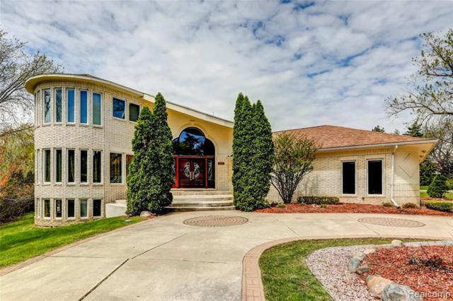 4201 Woodlands Lane, Orchard Lake, MI 48323 (MLS #219049380) :: The Toth Team