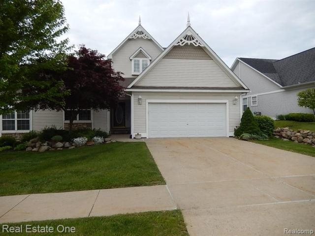 128 Victoria Park Drive, Howell, MI 48843 (#219051284) :: The Alex Nugent Team | Real Estate One