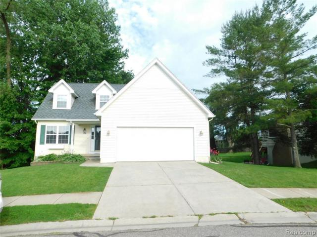 702 Pinegate Drive, Fowlerville Vlg, MI 48836 (#219059030) :: The Alex Nugent Team | Real Estate One