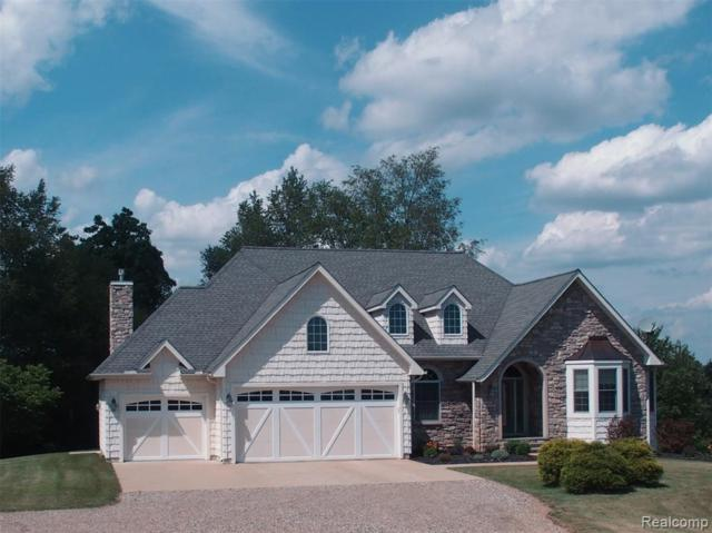 19742 Deerfield Court, Sylvan Twp, MI 48118 (MLS #219069123) :: The Toth Team
