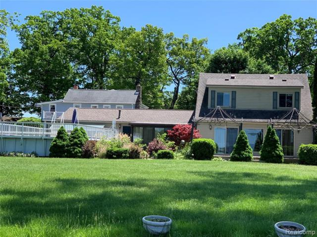 5733 Long Pointe Drive, Genoa Twp, MI 48843 (#219069713) :: The Mulvihill Group
