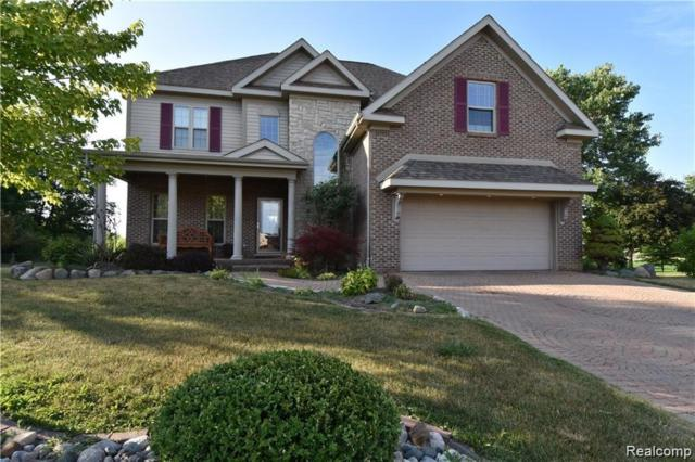 7100 Woods West Drive, Clayton Twp, MI 48433 (MLS #219069736) :: The Toth Team