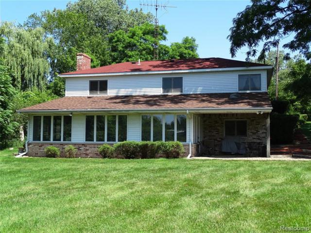 11004 White Lake Road, Tyrone Twp, MI 48430 (#219073793) :: The Buckley Jolley Real Estate Team
