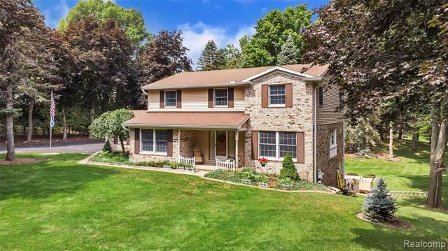 11361 Meadowood Drive, Brighton Twp, MI 48114 (#219083682) :: The Mulvihill Group