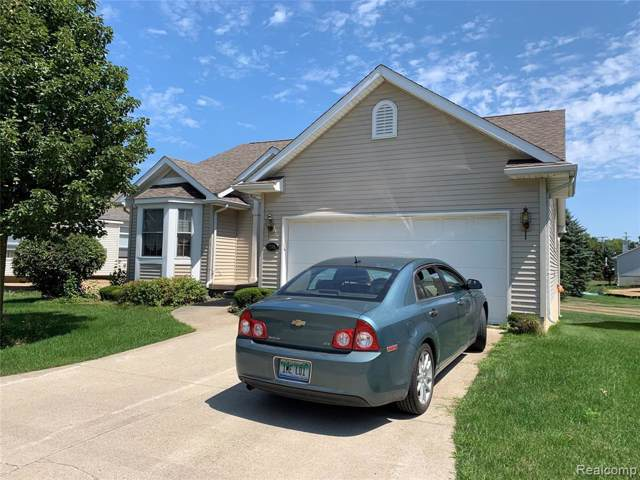 1164 Creekside Court, Burton, MI 48509 (#219083911) :: The Alex Nugent Team | Real Estate One