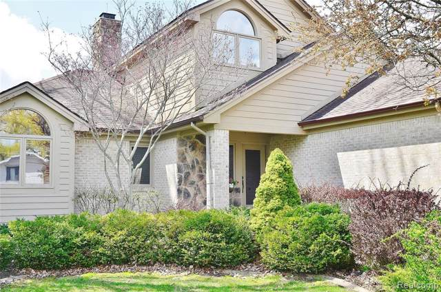 7120 Capri Drive, White Lake Twp, MI 48383 (#219086229) :: The Mulvihill Group