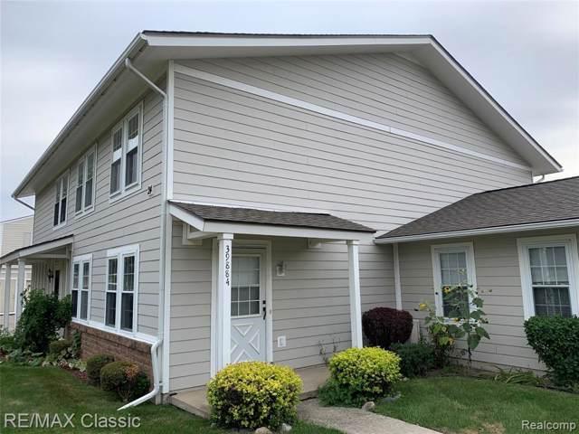 39884 Village Wood Circle, Novi, MI 48375 (#219092094) :: The Alex Nugent Team | Real Estate One