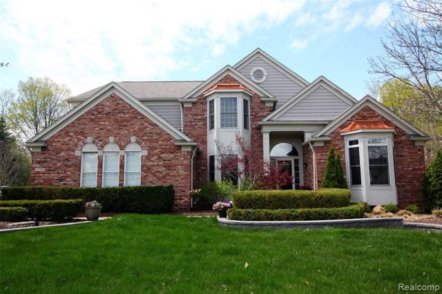 17359 Oak Hill Court, Northville Twp, MI 48168 (MLS #219094965) :: The John Wentworth Group