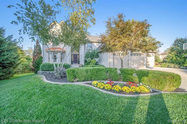 1235 Andover Court, Wixom, MI 48393 (MLS #219096781) :: The Toth Team