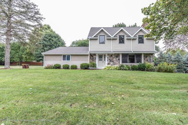 4215 N Whitby Lane, Bath Twp, MI 48808 (MLS #630000241047) :: The Toth Team