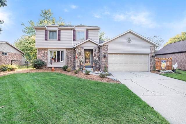 1403 Westport Drive, Delta Twp, MI 48917 (MLS #630000241616) :: The Toth Team